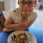 Lilly with pancakes at Centre Parcs